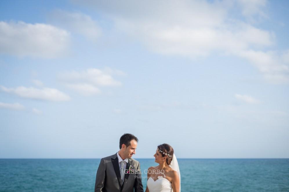 49 mirada novios reportaje boda mar al fondo